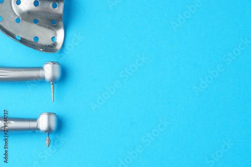 Keuken foto achterwand Vliegtuig Metal dental bur on blue background, top view