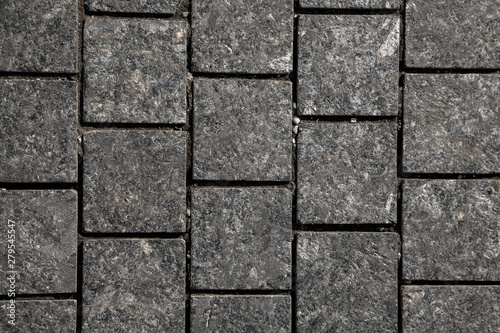 Abstract background of gray cobblestone pavement,close-up, top view Canvas Print