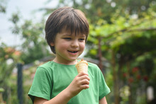 Happy Little Boy Eating Ice Cream. Closeup Of Child Eating Ice Cream In The Park