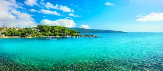 Seaside with turquoise bay and beach in Krk. Krk island, Croatia