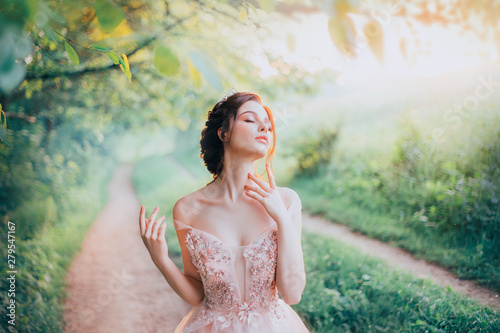 Fotografie, Obraz charming goddess of the spring forest stands on a narrow path and breathes in th