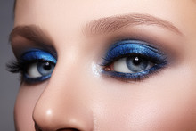 Closeup Macro Of Woman Face With Blue Eyes Make-up. Fashion Celebrate Makeup, Glowy Clean Skin, Perfect Shapes Of Brows