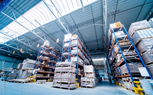 Warehouse industrial company. Commercial warehouse. Crates stacked on the shelves.