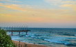 canvas print picture - Beautiful Umhlanga Promenade Pier a whalebone made pier in Kwazulu Natal Durban North South Africa during sunset
