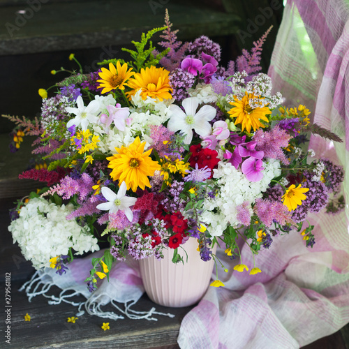 Fototapety, obrazy: Bouquet in a vase with summer bright flowers and a shawl on a wooden background of the old staircase