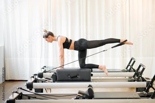 Fototapeta Woman performing a pilates diagonal stabilisation obraz