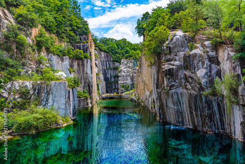 Staande foto Watervallen Granite valley The emerald green embrace. at pocheon Art valley, South Korea.