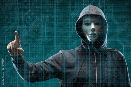 Fototapeta Computer hacker in mask and hoodie over abstract binary background