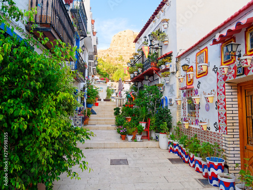A beautifully decorated street in Alicante, Santa Cruz. Spain. Fotobehang