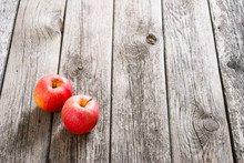 Two Apples On Old Wood Table