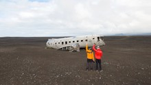 Plane Wreck On Beach In Iceland With Friends Celebrating