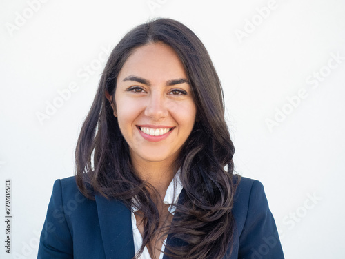 Happy successful businesswoman smiling at camera over white studio background Poster Mural XXL