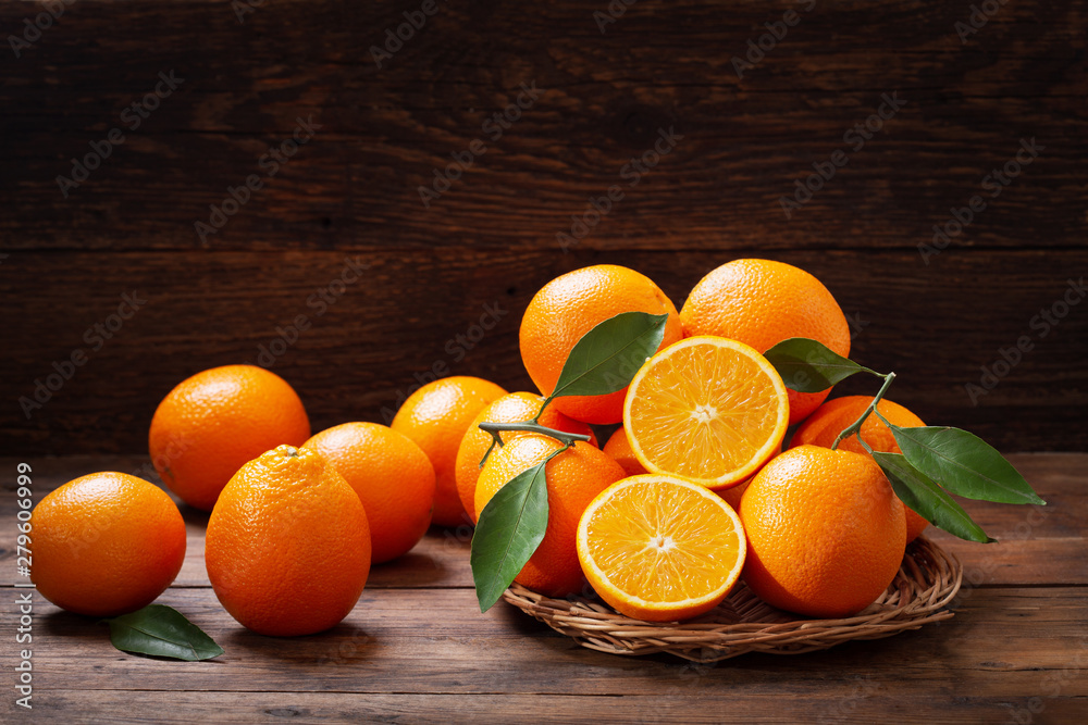 Fototapeta fresh orange fruits with leaves
