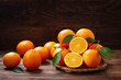 canvas print picture - fresh orange fruits with leaves