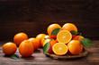 Leinwandbild Motiv fresh orange fruits with leaves