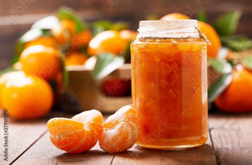 glass jar of orange tangerine or mandarin jam with fresh fruits Wallpaper Mural