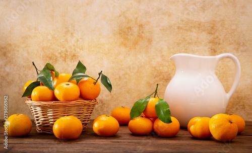 Fototapeta Fresh mandarin oranges fruit or tangerines with leaves obraz