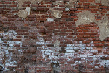 Wall Of Old Red Brick With Remnants Of Fallen Plaster