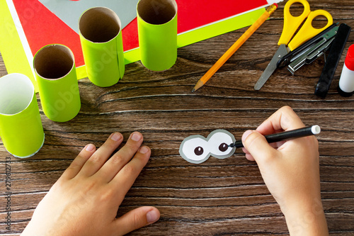 Fotografie, Obraz  Child draws details Paper Roll Pencil Holder the new school year