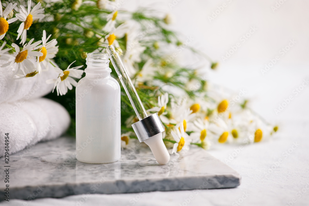 Fototapety, obrazy: Composition with skin care products in zero waste package and chamomile flowers on marble plate, Concept of flowers and organic cosmetic. Essential camomile oil