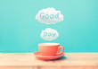 canvas print picture - Happy moment with a cup of coffee and good day text on wood bar table background