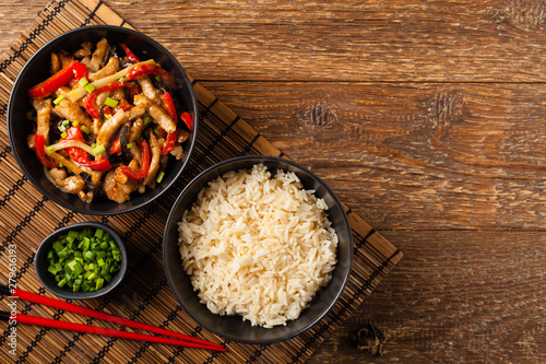 Pork chop with peppers, mushrooms and bamboo. Served with rice. Canvas Print