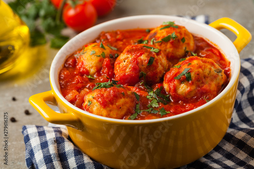 Chicken meatballs with tomato sauce. Served with rice. Fototapeta