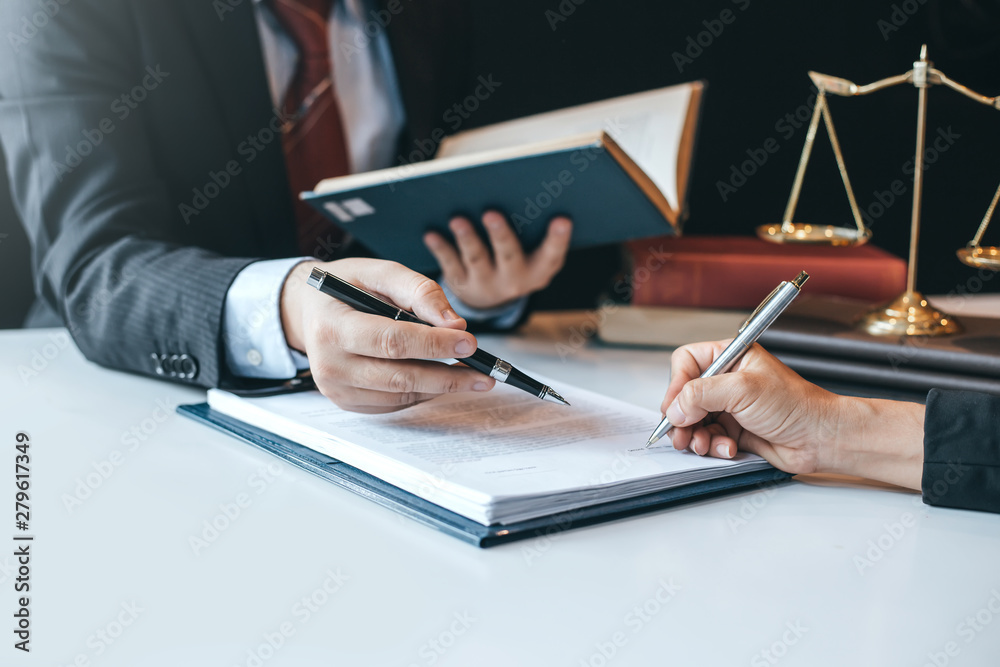 Fototapeta Businessman and lawyer discuss the contract document. Treaty of the law. Sign a contract business.