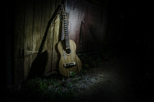 An Wooden Acoustic Guitar Is A...