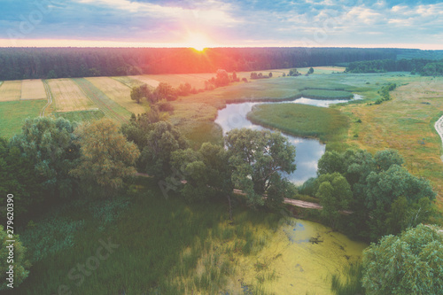 Poster Kaki Magical sunset over the countryside. Rural landscape in the evening. Aerial view