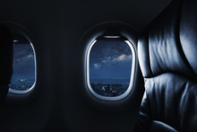 Looking Through Airplane Window At Night With Sky Full Of Stars And Milky Way