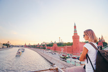 Traveling By Russia. Young Woman With Rucksack Enjoying Kremlin And Moscow River View.