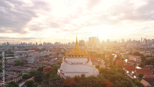 Aerial view of Wat Saket in Bangkok - Temple of the Golden Mountain, Wat Saket, popularly known as the Golden Mount or 'Phu Khao Thong , is a low hill crowned with a gleaming gold chedi Wallpaper Mural