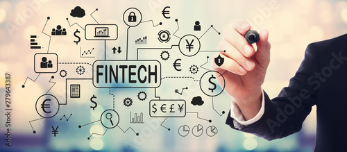Fintech theme with businessman on blurred abstract background