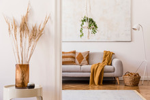 Minimalistic Boho Interior With Design Sofa, Pillows, Lamp, White Coffee Table With Plant, Flowers And Elegant Accessories. Mock Up Poster Frame On The Wall.  Stylish Home Decor. Template.