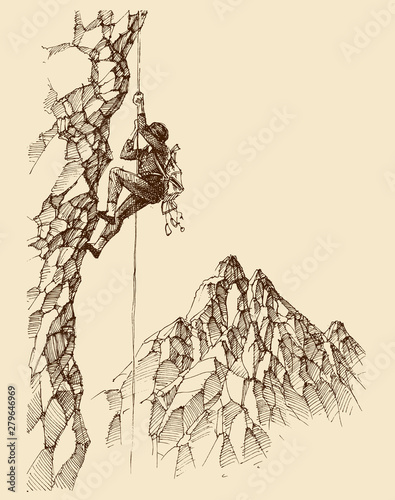 Photo Man climbing a rocky mountain wall wallpaper