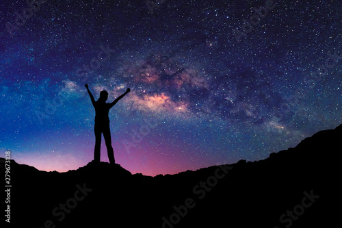 Foto auf AluDibond Kosmos Happy freedom woman on the mountain with starry night sky milkyway. freedom and victory concept.