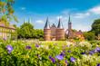 Leinwandbild Motiv Historic town of Lübeck with famous Holstentor gate in summer, Schleswig-Holstein, northern Germany