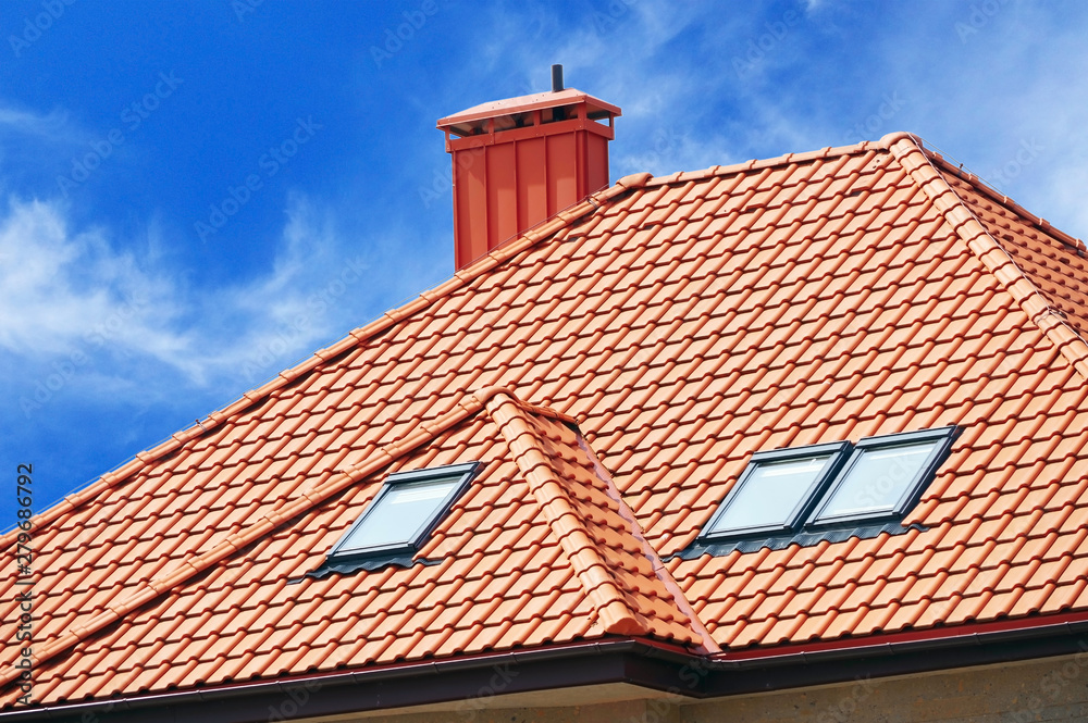 Fototapeta roof of the house of red tiles on background sky