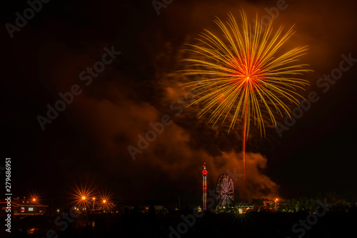 Foto op Plexiglas Artistiek mon. Beautiful fireworks over Atlantic Highlands, New Jersey in celebration of 4th of July , featuring amusement park on the background