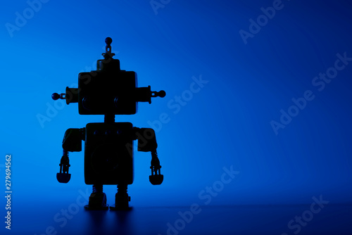 Silhouette of a cute robot on a blue background. Canvas Print