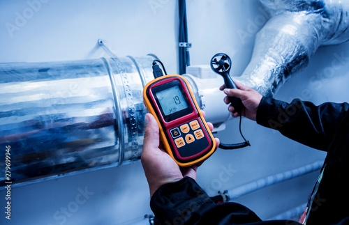Technician use hand-held anemometer measuring air flowing measurement, wind speed and pressure Canvas Print