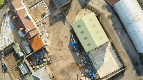 Farm and farmyard buildings in rural countryside aerial view from above Canvas Print