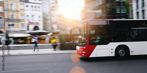 plakat bus in city traffic in motion blur
