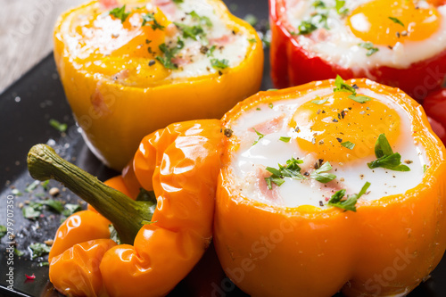 Fototapeta Baked pepper stuffed with bacon and eggs obraz
