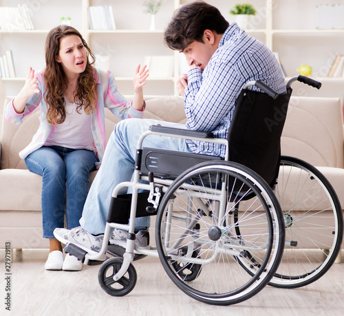 Photo  Desperate disabled person on wheelchair
