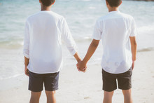 Asian Gay Couple Holding Hands Together On The Beach With Relax And Leisure In Summer, LGBT Homosexual Legal Two Man Happy And Romantic In Vacation, Relationship Sex Lover Concept.