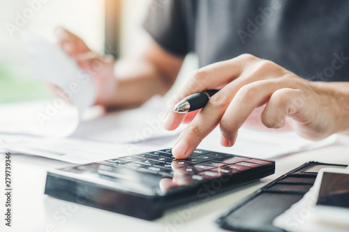 Canvastavla Man using calculator Accounting Calculating Cost Economic bills with money stack