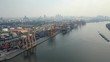 Drone shot approaching a riverside container port in Bangkok, Thailand