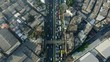 Drone shot flying over busy road in Bangkok and panning up to reveal skyline